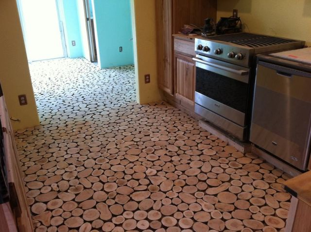 Cordwood flooring by Sunny Pettis Lutz in Cornville, AZ